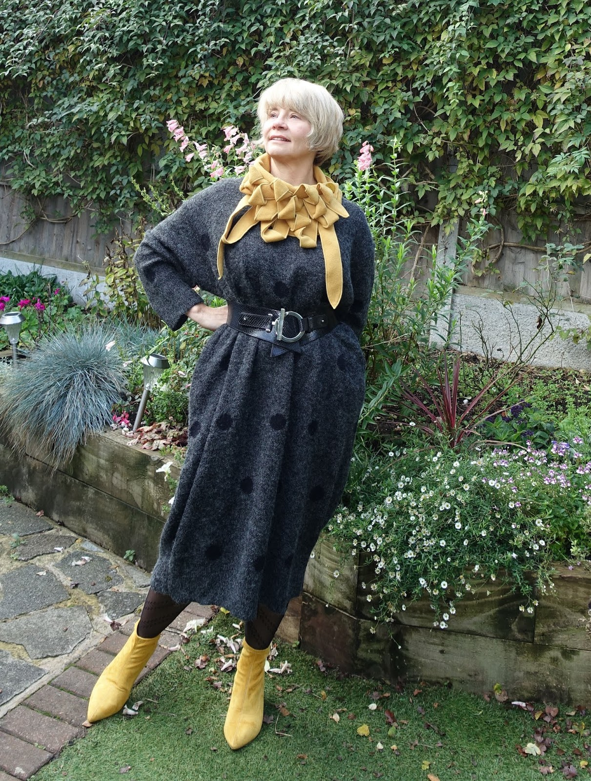 Mustard accessories - a dramatic collar and sock ankle boots - add some drama to a grey wool sweater dress from Eva Trends. An idea outfit for the over 50s to wear in winter, either to work or out socialising.