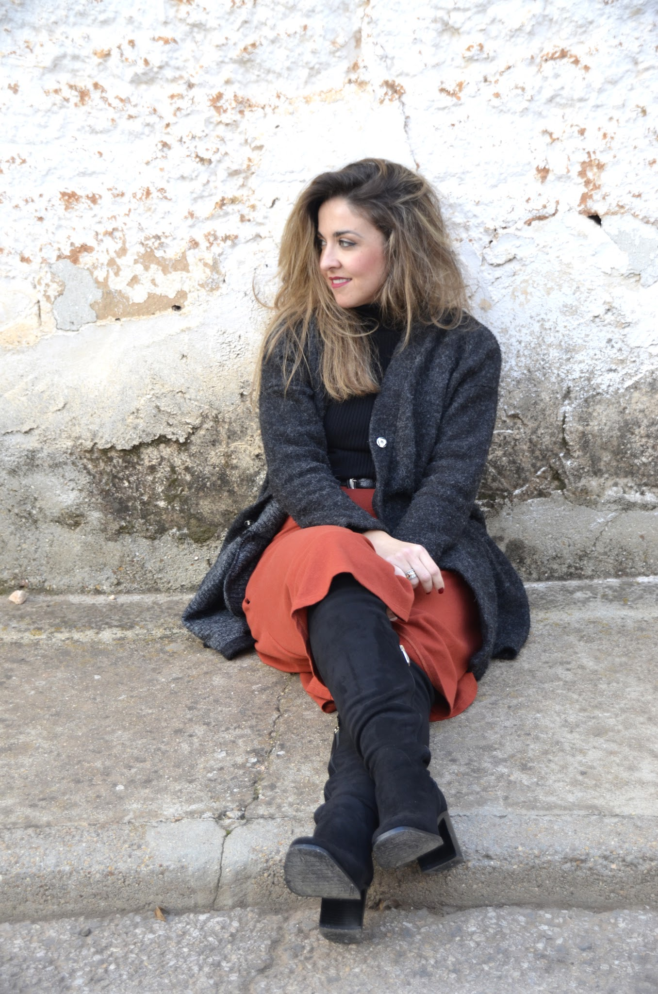over the knee boots and midi skirt with grey cardigan
