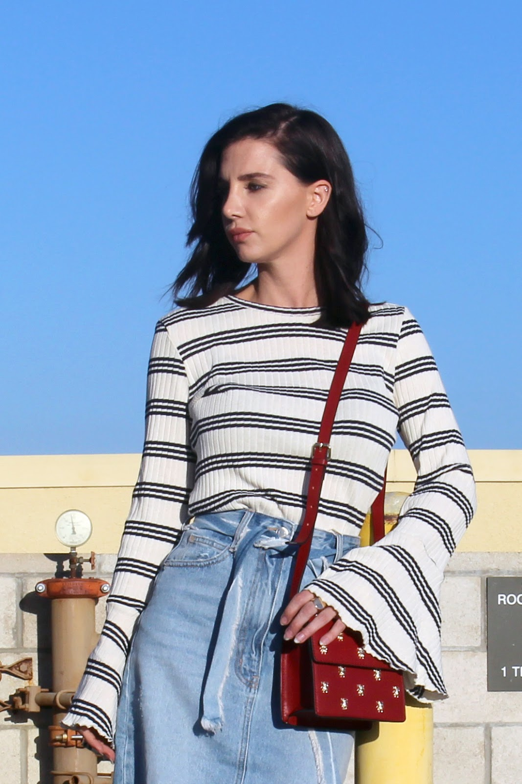 denim midi skirt, flared sleeve top, red mini bag