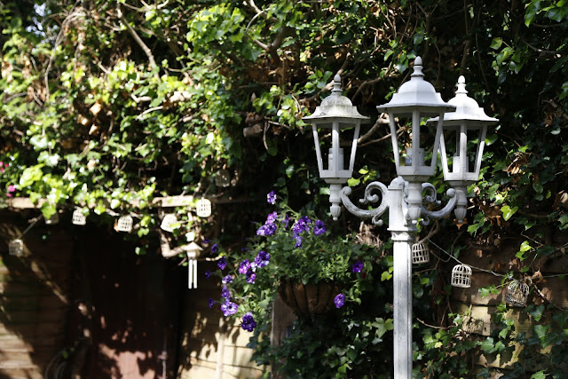 Shabby Chic White Antique Lamppost in Garden