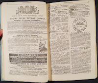 An open booklet of printed text.