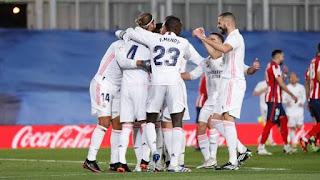 Real Madrid players celebrating Casemiro's goal