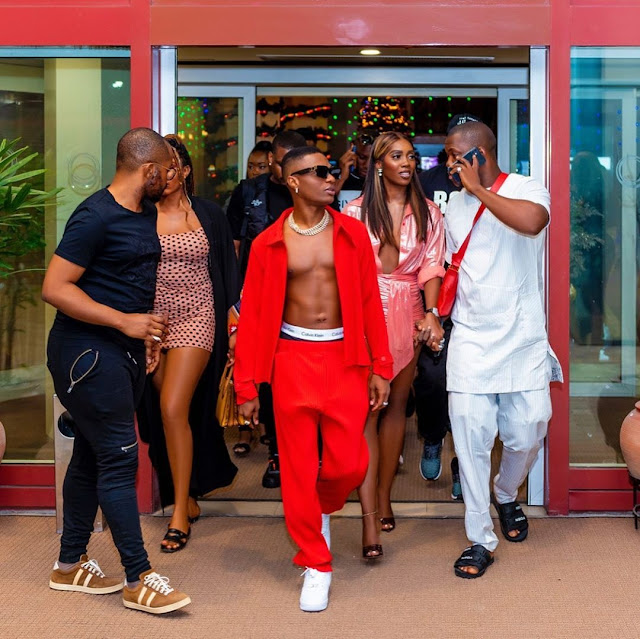 Santa In Abuja! Wizkid Steps Out In Style With Tiwa Savage For His Concert