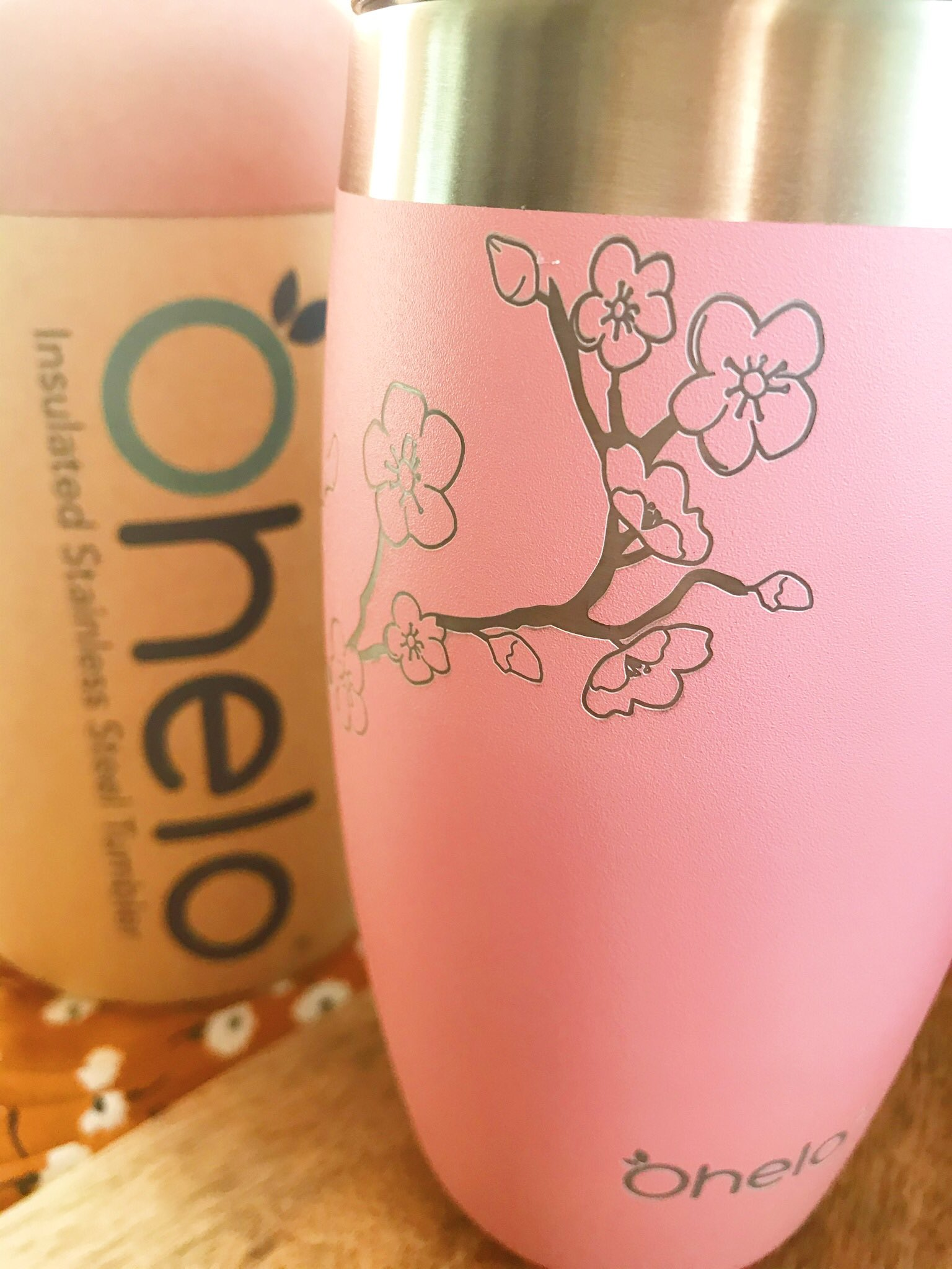Ohelo Pink Blossom Travel Cup stood up with packaging in background