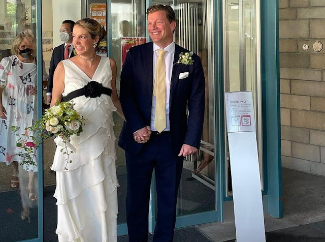 Tessy Antony wore a white ruffled wedding gown with a black belt, she accessorised with a diamond necklace and earrings