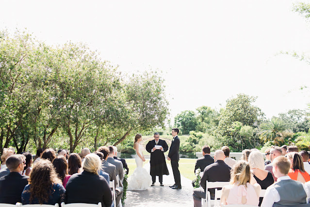 bride and groom at altar outdoors