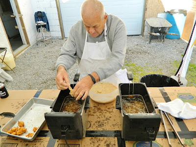 Frying up battered animal testicles at the Testicle Festival