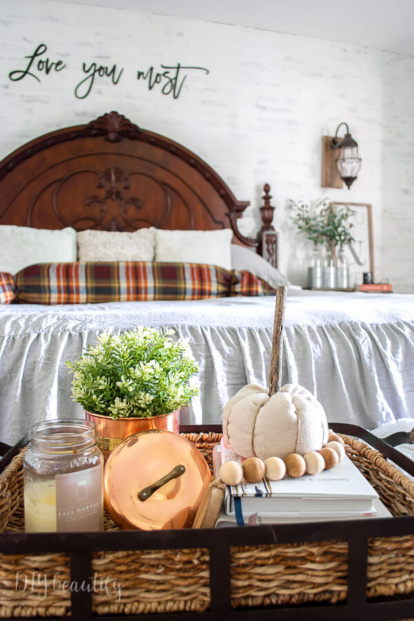 Fall bedroom decor with copper and plaid