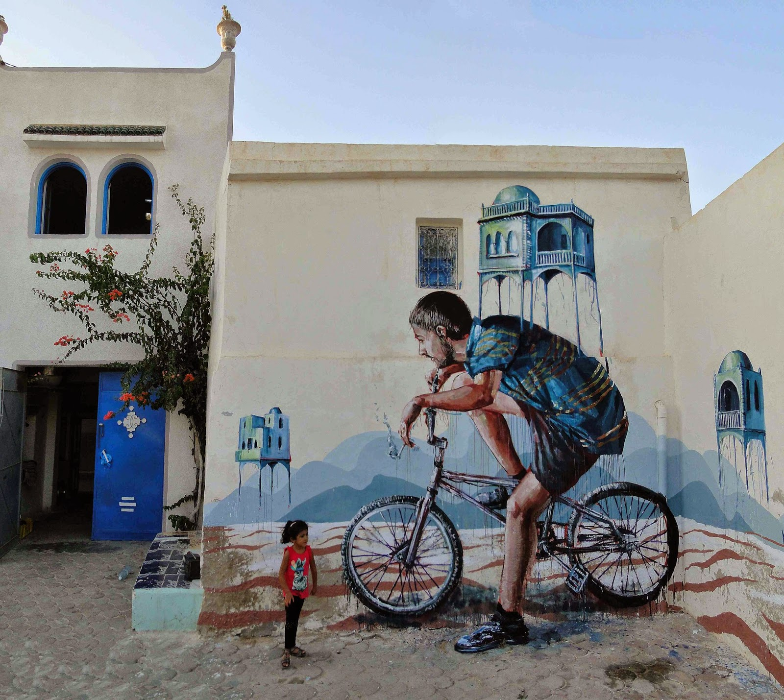 Our friend Fintan Magee is currently in North Africa where he just finished working on this new piece for the Djerbahood project on the island of Djerba in Tunisia.