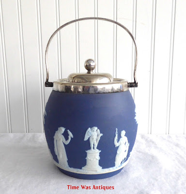 https://timewasantiques.net/products/wedgwood-england-biscuit-barrel-blue-jasperware-dip-blue-1895-sacrifice-figures