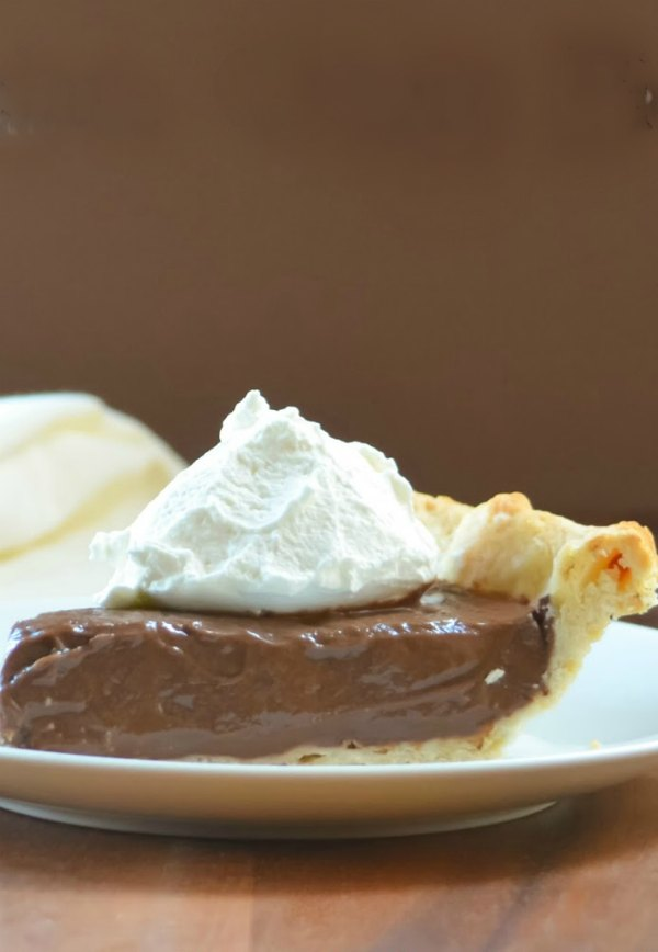Chocolate Creamy Pie recipe is a flaky pie shell filled with creamy Chocolate Pudding from scratch. A favorite dessert recipe for Thanksgiving and Christmas from Serena Bakes Simply From Scratch.