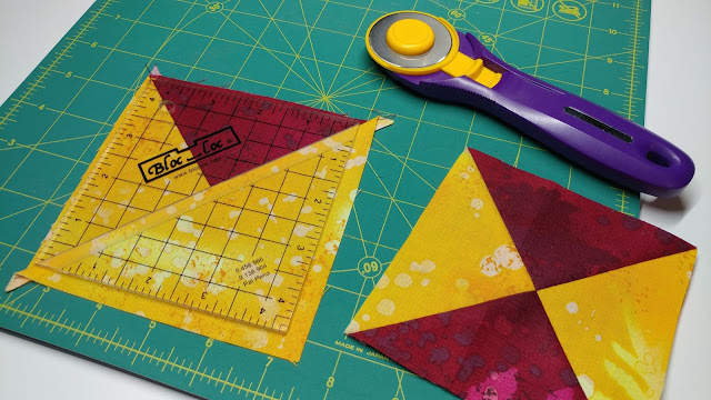 Trimming quarter square triangles with a Bloc Loc ruler