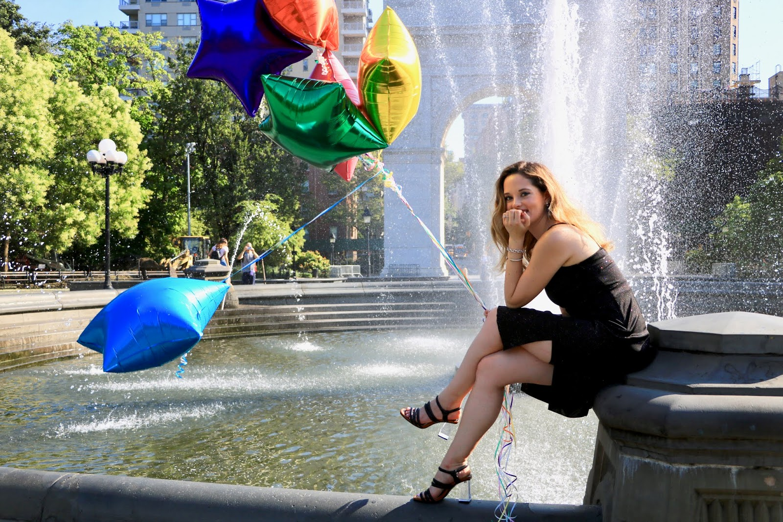 Nyc fashion blogger Kathleen Harper doing a balloon photoshoot.