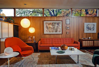 Mid-century interior idea with orange sofa and chair