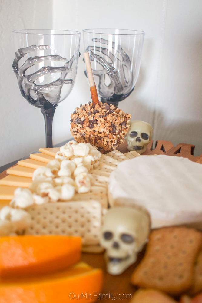 Skeleton hand wine glasses and halloween skull cheeseboard