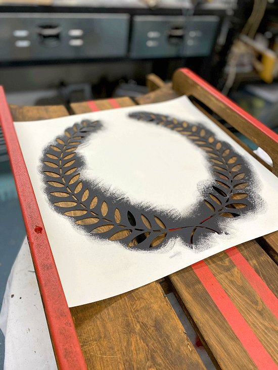 A wreath stenciled wooden sled