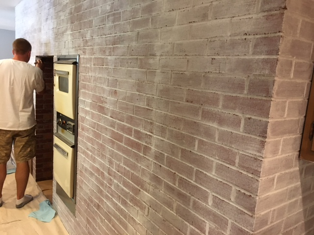 Whitewashing a brick wall - 1st coat