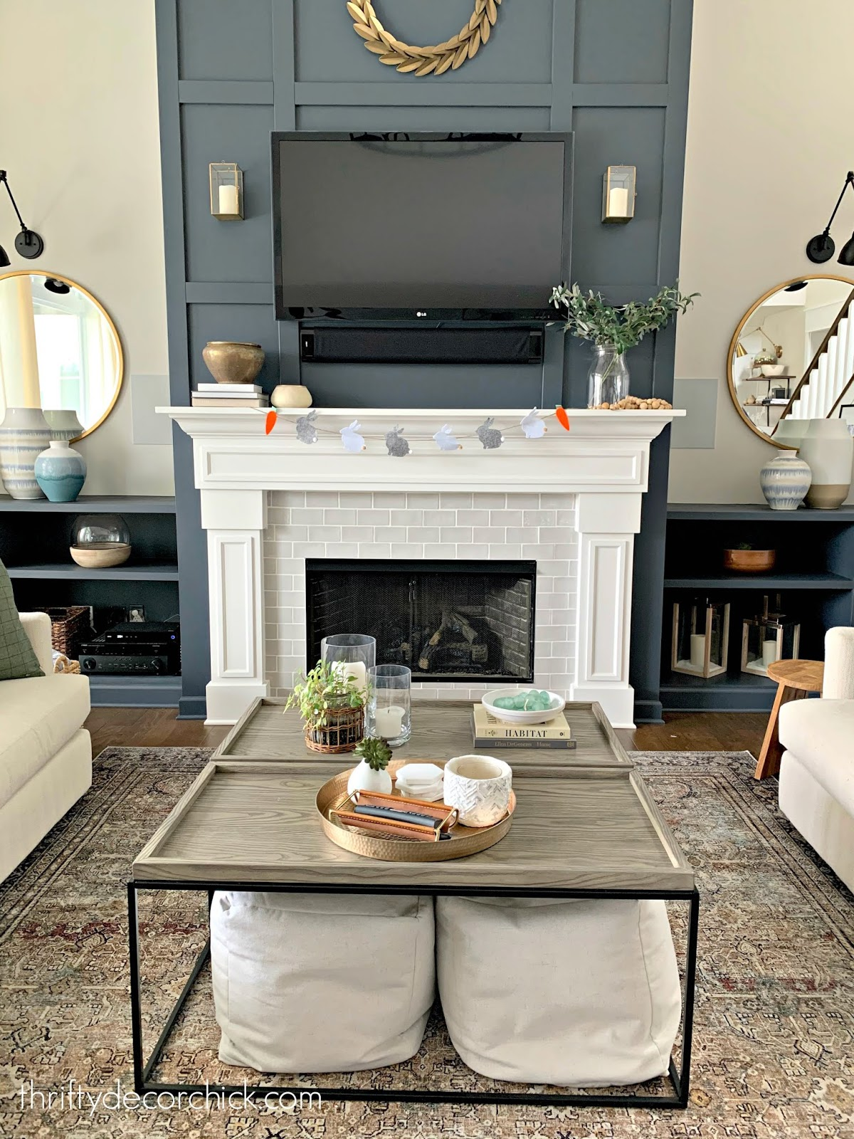 Tall fireplace with dark paint and grid trim work