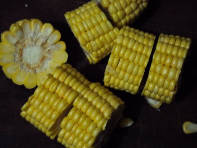 sweet corn on the cob curried with tomato concasse