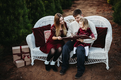 Family on bench reading book for Christmas Holiday Mini Session in San Diego