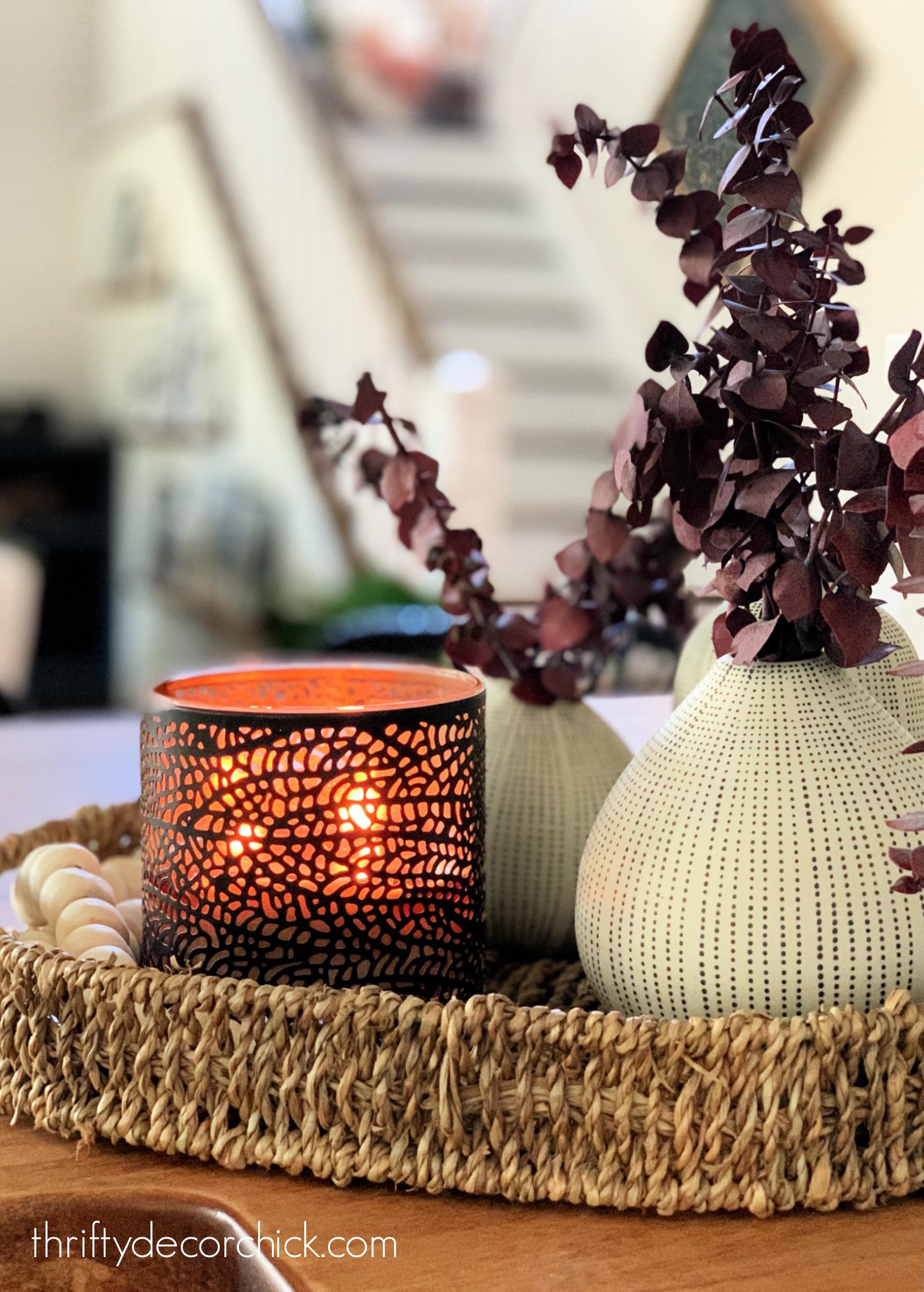 Stone vase, metal candle in rattan basket