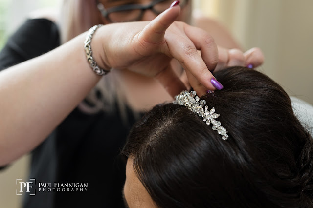 hairdresser putting tiara in hair