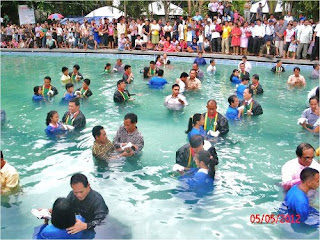 water baptism conducted in swimming pool