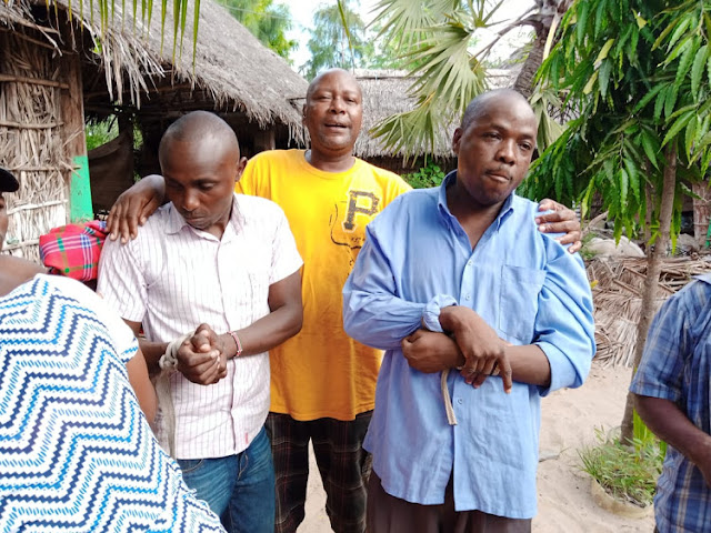 Two Police officers tied up by Angry villagers in Lamu. PHOTO | BNC