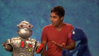 Kunal Nayyar, celebrity, Grover, the Word on the Street Robot, Sesame Street Episode 4406 Help O Bots, Help-O-Bots season 44
