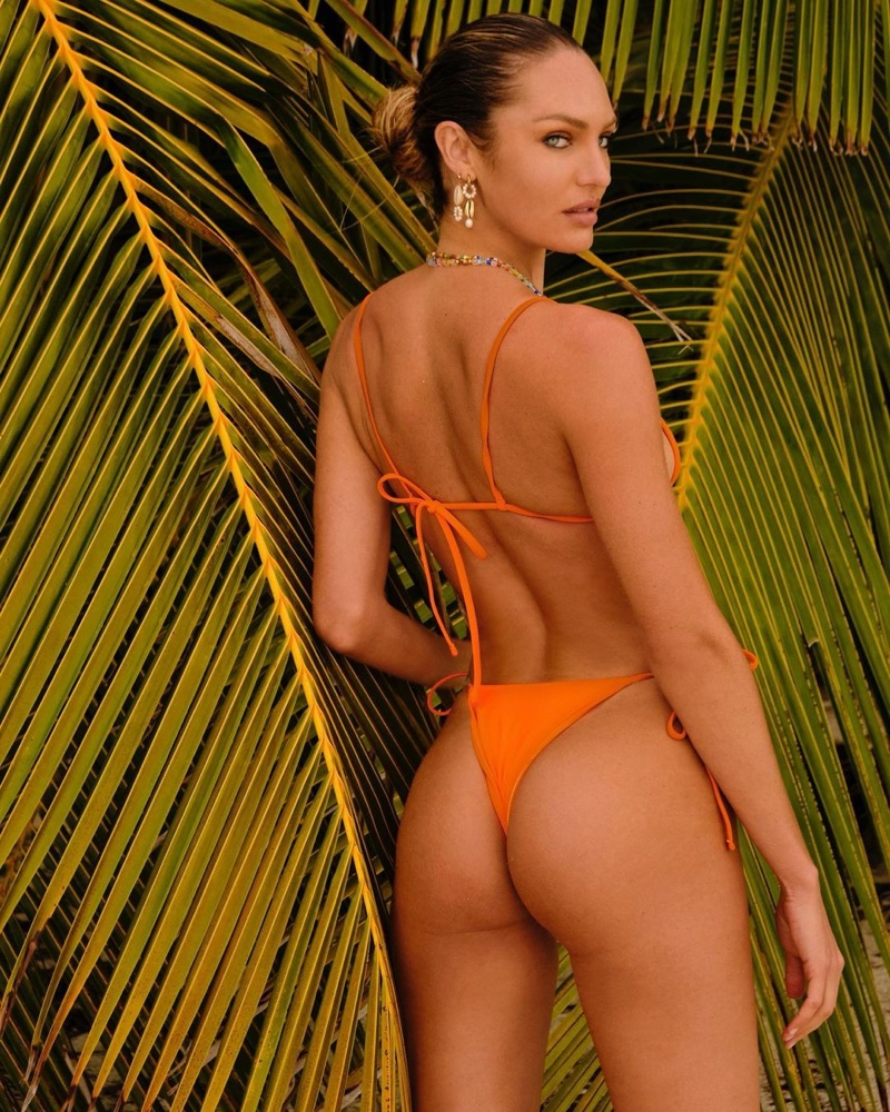 Candice Swanepoel wears Tropic of C Equator top and Praia bottom in papaya.
