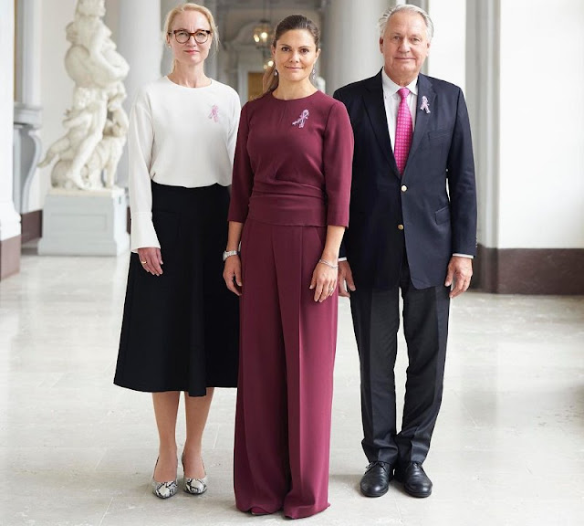 Crown Princess Victoria wore wine-red Kamille trousers and Kiana blouse from Andiata. Cancer Foundation's Secretary General Ulrika Arehed Kagstrom