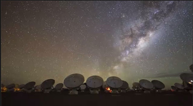 Dark skies with ALMA array in foreground (Source: ALMA Collaboration)