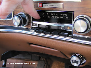 Radial Tuned Suspension emblem is mounted above the radio.