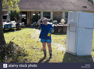 Sour Lake, Texas Sept. 6, 2017: Residents in the Pinewood subdivision outside Sour Lake face the daunting task of cleaning up their homes as they were just let back into the area Wednesday, nine days after floodwater decimated the area after Hurricane Harvey. Credit: Bob Daemmrich/Alamy Live News (Credit:  Bob Daemmrich / Alamy Stock Photo) Click to Enlarge.