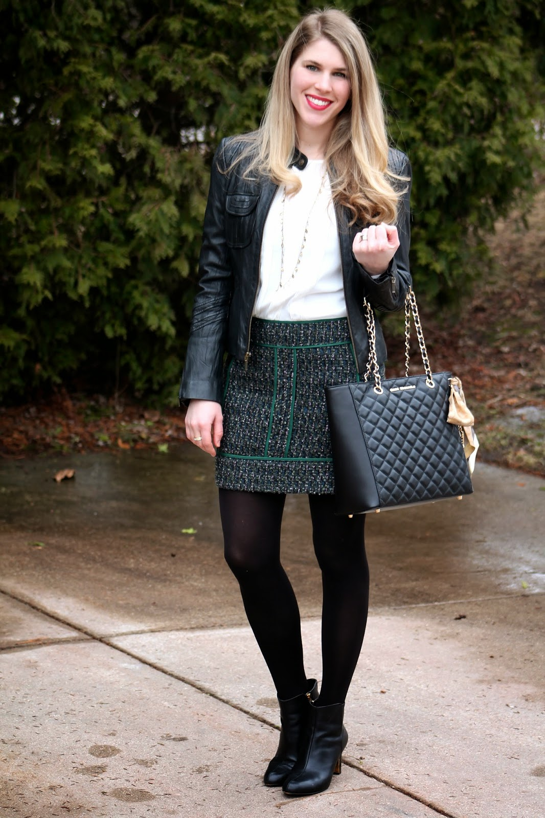 white chiffon blouse, black moto jacket, green black tweed skirt, booties, quilted leather tote bag
