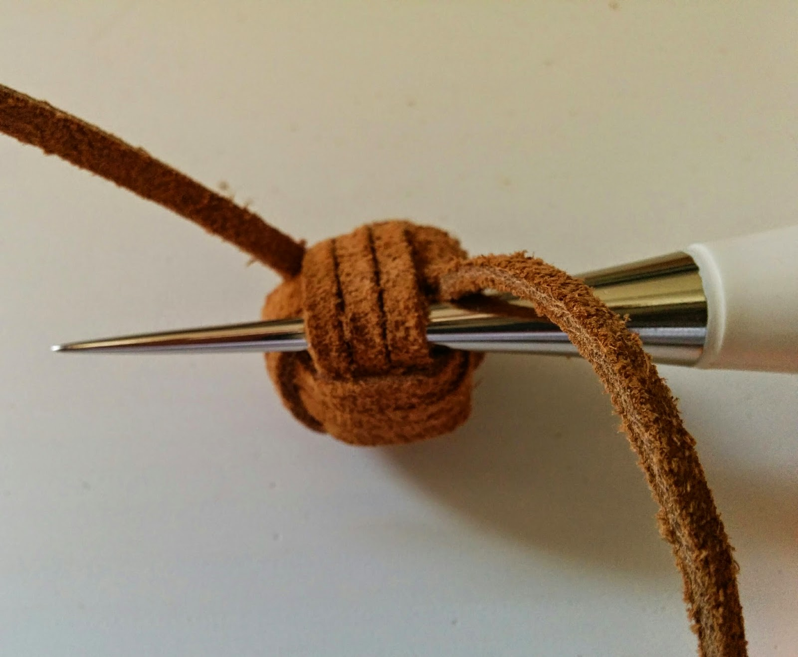 Make a knot like the one shown above. I like to use three wraps per  section cd0b2103c