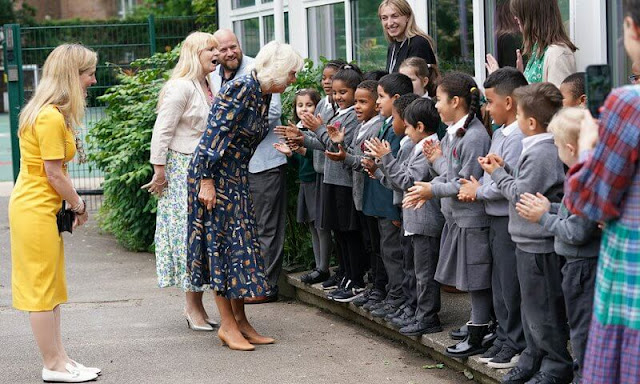 The Duchess of Cornwall wore a navy blue, feather-print dress from Fiona Clare