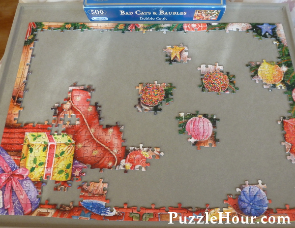 Working on a 500 piece Gibsons jigsaw puzzle Bad Cats and Baubles