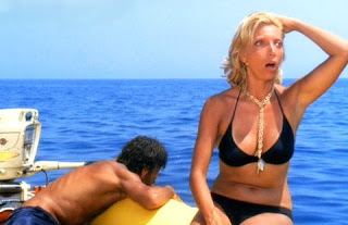 Melato with Giancarlo Giannini in Wertmüller's Swept Away, regarded as among her finest work