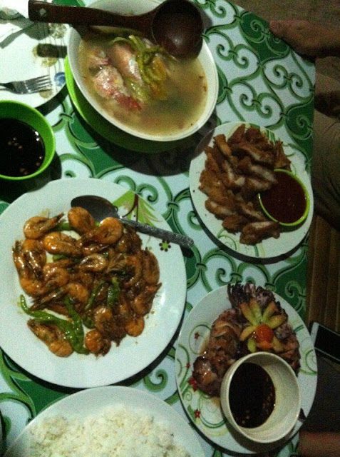 Complete meal menu - Sinigang na Isda, Garlic Shrimp, Fried Pork, Pinakbet, Inihaw na Pusit and Rice