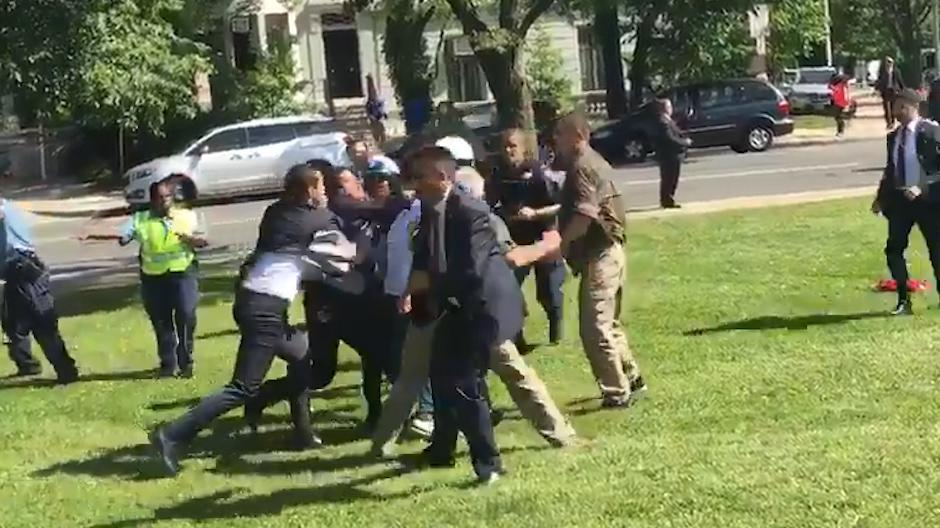 Turkish President Erdogan's security detail, seen here in dark suits, clashed with Kurdish protesters in Washington DC