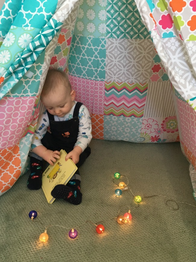 Alfresia-play-teepee-with-baby-reading-book