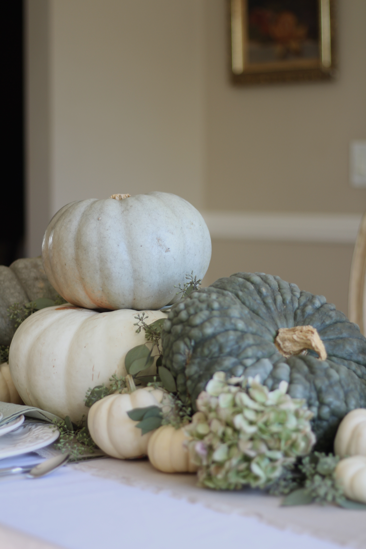 neutral fall tablescape with green pumpkins and gorgeous dried hydrangeas