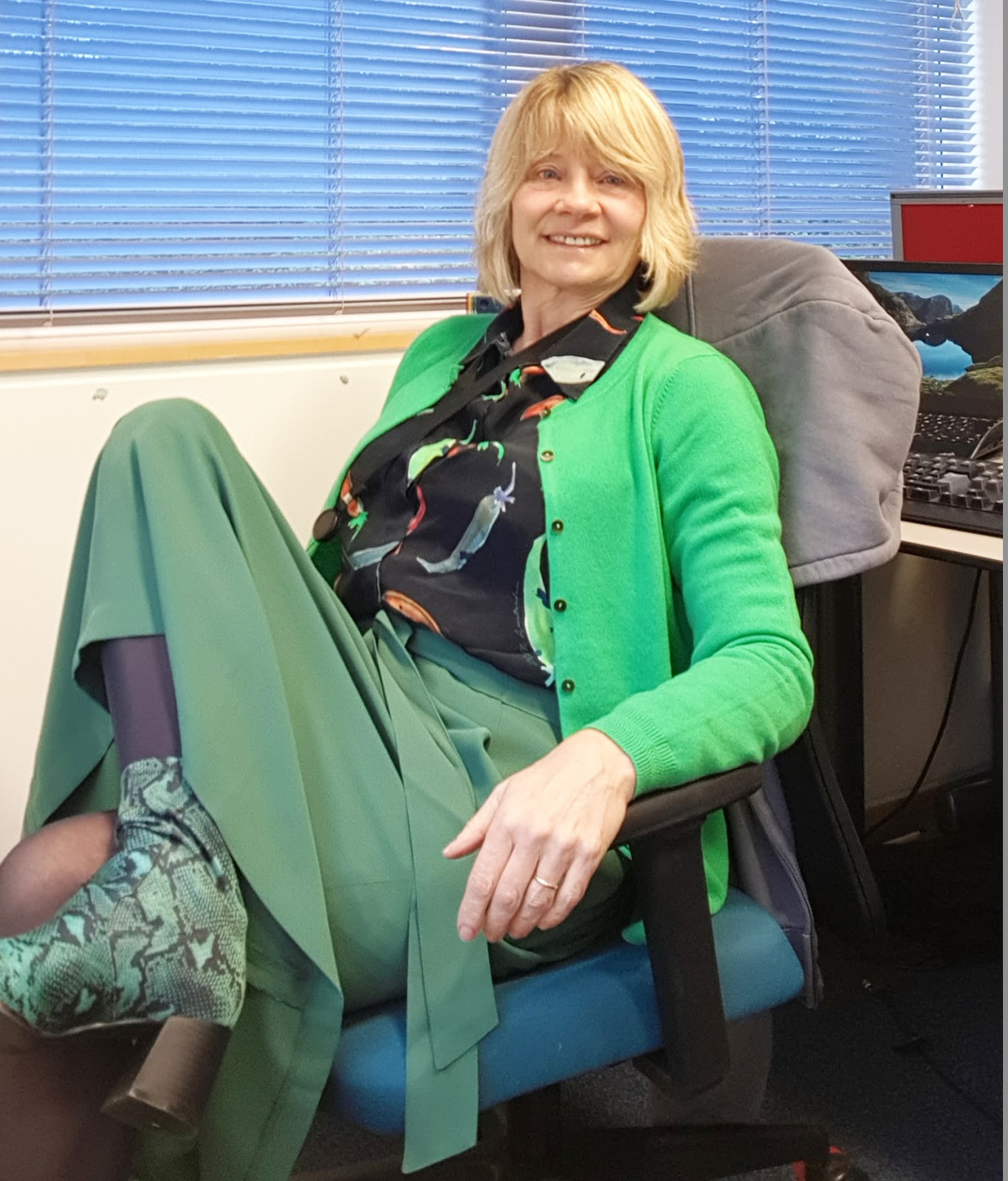Over-50s style blogger Gail Hanlon from Is This Mutton in tones of green with snakeskin boots