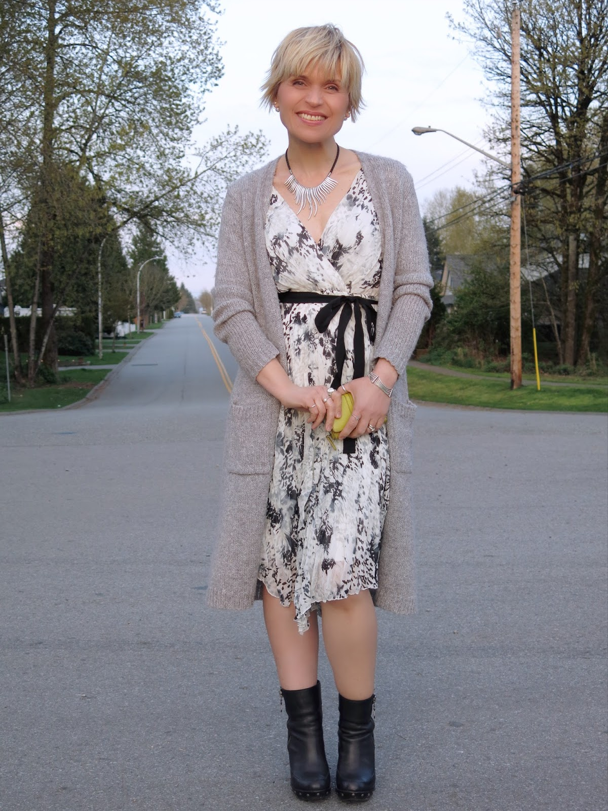 styling a printed chiffon dress with booties and a long cardigan