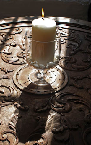 Candle on carved wood tabletop, photograph by LeAnn B at home for linenandlavender.net - http://www.linenandlavender.net/2012/07/essential-oils-gifts-of-nature.html