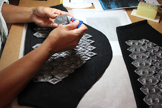 Gluing scales for Thorin's scalemail armor sleeves.