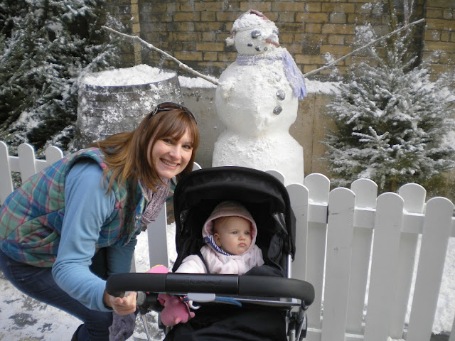 Tin Box Traveller and Tin Box Tot with a snowman at the Victorian Christmas Festival