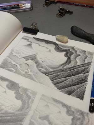 small planning drawings of a volcanic landscape