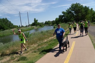 Maryann Migliorelli with guide dog Uno racing along the Mary Carter Greenway in Littleton Colorado during the second annual 6 Dot Dash 5k (Guiding Eyes for the Blind)